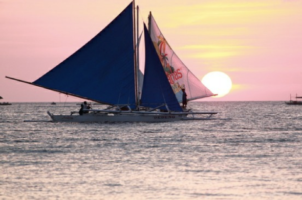 sail boat in sunset